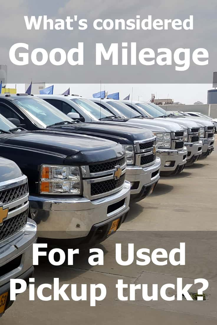 Chevrolet Silverado pickup trucks parked on car dealership, What's Considered Good Mileage for a Used Pickup Truck?