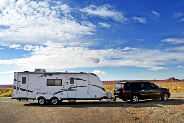 SUV towing a travel trailer
